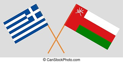 Crossed flags of Oman and Greece