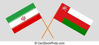 Crossed flags of Oman and Iran