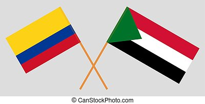 Crossed flags of Sudan and Colombia