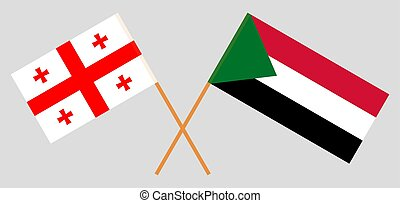 Crossed flags of Sudan and Georgia