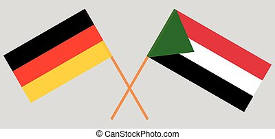 Crossed flags of Sudan and Germany