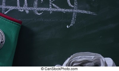 Crossed out writing on the blackboard, close-up