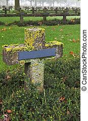 crosses at cemetery in autumn mist stone tombstones