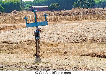 Crosses by the road and farmland near Bahir Dar in Ethiopia