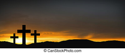 Crosses on the hill over sunset background. Religious concept of crucifixion