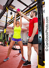 Crossfit fitness Kettlebells swing exercise personal trainer...