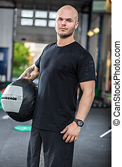 Crossfit traning man with med-ball - Young trained man with...
