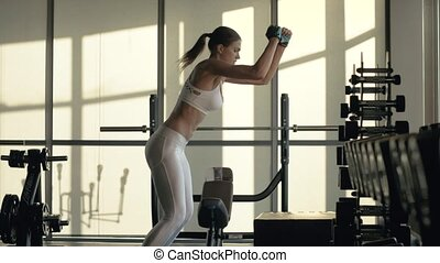 Crossfit woman jumping on platform on fitness training in gym club