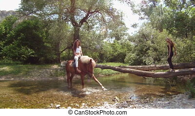 Crossing a river on a horse