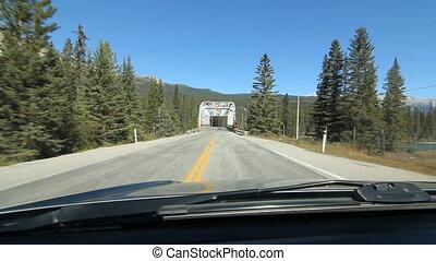 Crossing a truss bridge. Alberta.