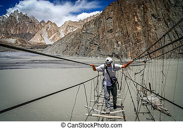 Crossing dangerous bridge - Traveller crossing dangerous...
