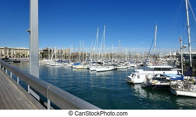 Crossing Maremagnum Marketplace Bridge in Barcelona -...