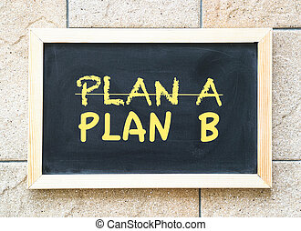 Crossing out Plan A and writing Plan B concept