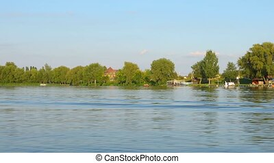 Crossing river on motorboat - Crossing the river Tisza on...