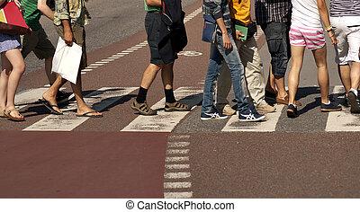 Crossing street - Legs of people crossing a street with...
