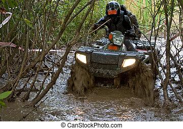 Crossing the dirt river - Sportsman riding quad bike at...