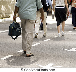 Crossing The Road - Pedestrians crossing a road in a...