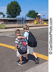 Crossing to school - Siblings cross the street at a cross...