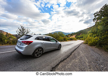 Crossover Rides the Highway in a Mountainous Area