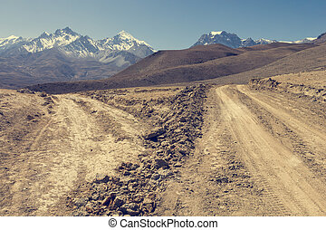 Crossroad in arid wasteland. Annapurna circuit trek in Nepal.
