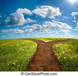 Crossroad on Hill - Crossroad in rural landscape on meadow...