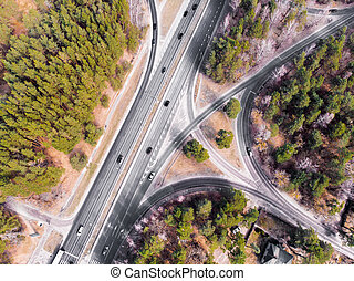 Crossroad with cars and forest from air in Spring