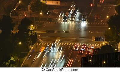 Crossroads traffic timelapse at night - Crossroads traffic...