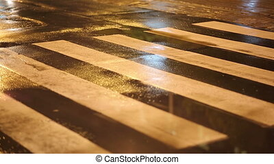 Crosswalk at Night - guy in white sneakers crossing the road