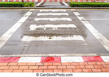 Crosswalk in the city after rain.Zebra traffic walk