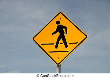 Crosswalk road sign against blue sky