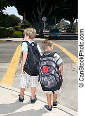 Crosswalk safety - Two brothers watch for traffic at a...