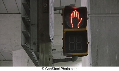 Crosswalk signal. - A crosswalk signal changes from stop to...