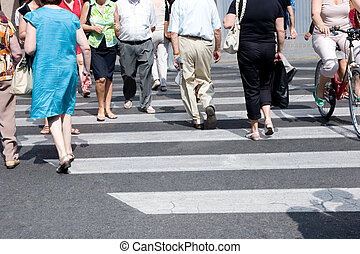 Crosswalk - People crowd crossing the street in a city