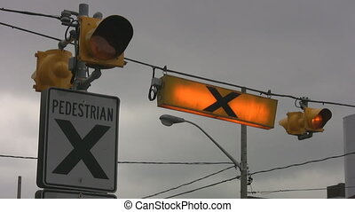 Crosswalk. - A crosswalk sign with flashing light tells...