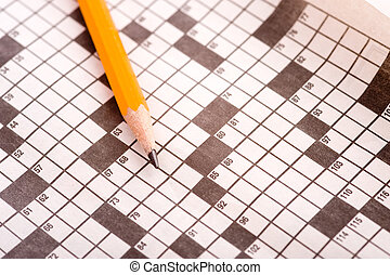 A blank crossword puzzle with a yellow pencil.