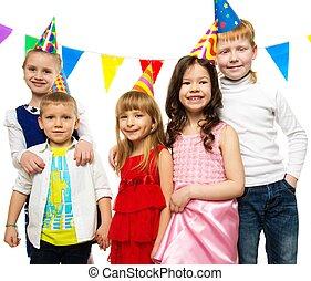 Croup of happy children celebrating birthday
