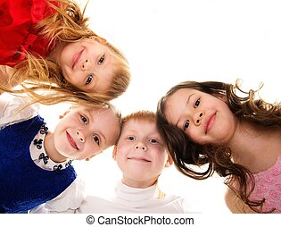 Croup of happy children standing in a circle