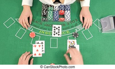 Croupier and Player at Poker Table