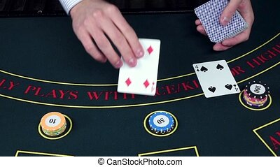 Croupier deal cards on table with chips, casino, slow motion