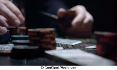 Croupier dealing cards in a poker