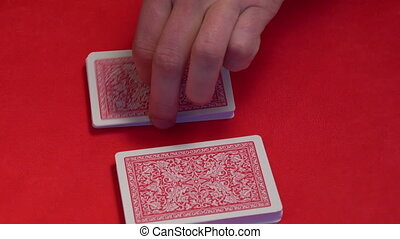 Croupier shuffling cards on gambling table. - Croupier...