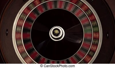 Croupier spins the classic roulette, quickly, white ball -...