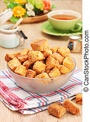 Croutons - Delicious fried croutons in glass bowl on wooden...