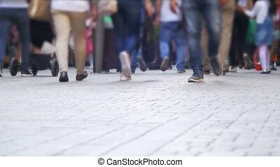 Crowd Anonymous People Walking on the Street. Crowd Feet. -...