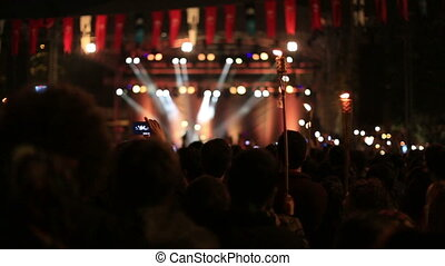 crowd at concert - many people at concert area and light...