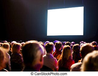 Crowd audience looking at screen - Crowd audience in dark...