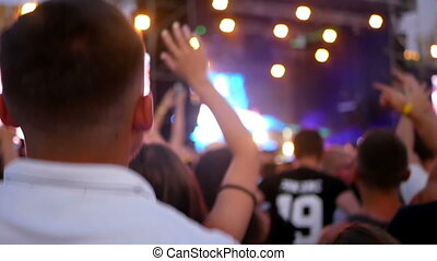 Crowd concert silhouetted hands - Crowd partying at a rock...