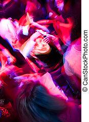 Crowd dancing in the nightclub