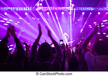 Crowd enjoying concert, large group celebrating new year holiday, party background fun concept, blurred