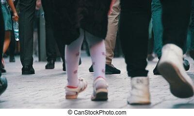 Crowd Feet of People Walking on the Street. Slow Motion